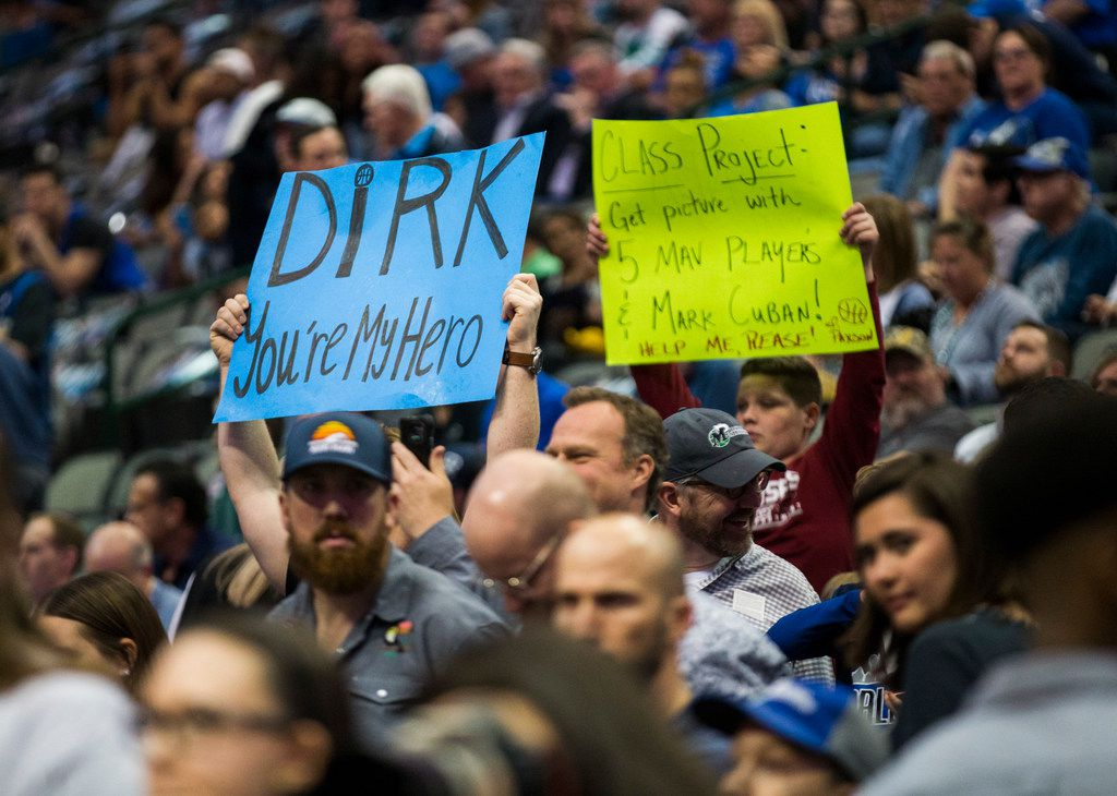 Fans of Dallas Mavericks forward Dirk Nowitzki (41) hold up signs during warmups before an NBA game between the Dallas Mavericks and the New Orleans Pelicans on Monday, March 18, 2019 at American Airlines Center in Dallas. (Ashley Landis/The Dallas Morning News)