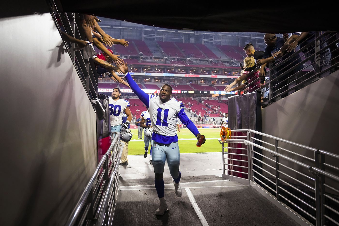 Dallas Cowboys linebacker Micah Parsons (11) high fives fans as he leaves the field after during a preseason NFL football game against the Arizona Cardinals at State Farm Stadium on Saturday, Aug. 14, 2021, in Glendale, Ariz.
