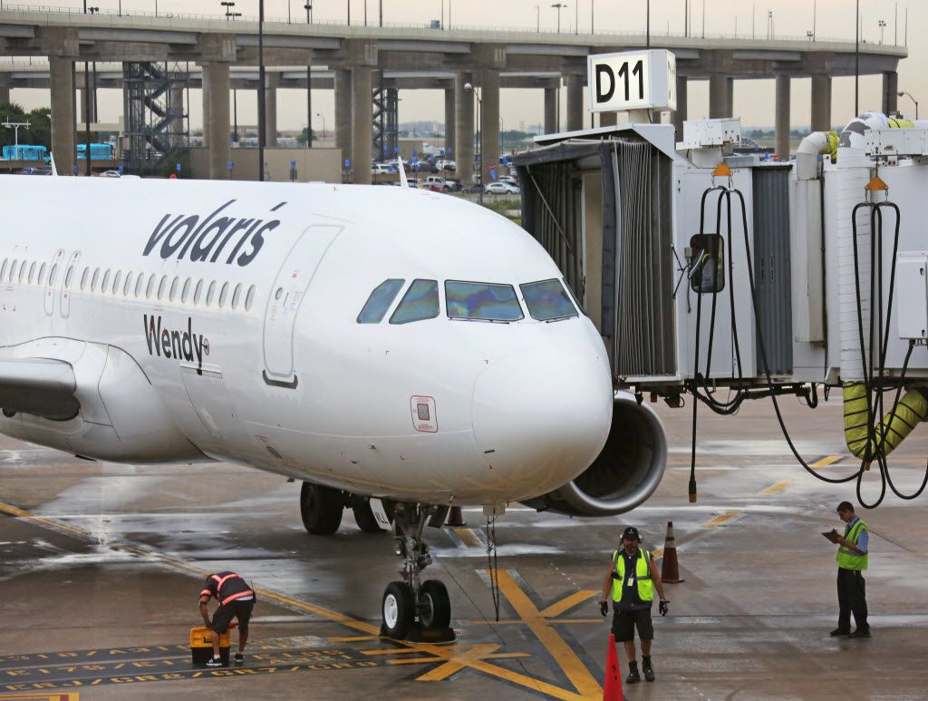 A Volaris plane pulls into Terminal D at DFW Airport, photographed on Monday, August 22, 2016. (Louis DeLuca/The Dallas Morning News)