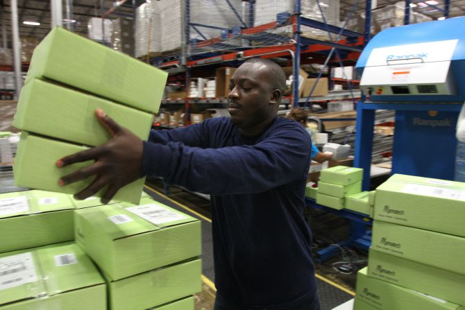 At a warehouse in Coppell, Abiola Gbolagun readies boxes of Mannatech supplements to be mailed out.