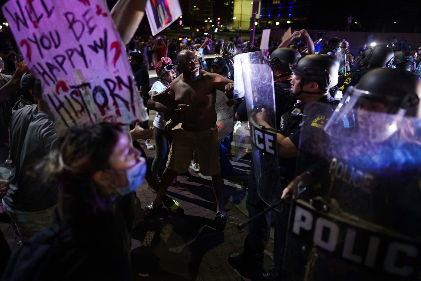 Dallas police clash with protesters at the corner of of Griffin and Young Streets as they march against police brutality on Friday, May 29, 2020, in Dallas.