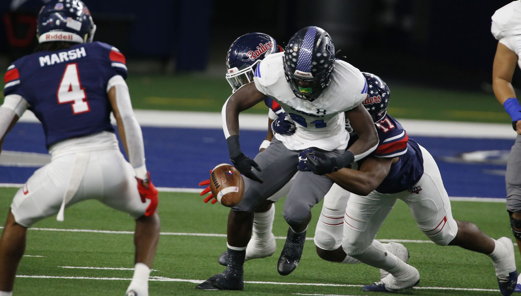 Mansfield Summit's Desmond Walton (84) fumbles the football, after being hit by Ryan's Michael Gee (17). The ball was scooped up by Denton Ryan defender Ty Marsh (4) and advanced for a touchdown during the first half of the Class 5A Division I state semifinal football playoff gameat AT&T Stadium in Arlington on Friday, January 8, 2021. (John F. Rhodes / Special Contributor)