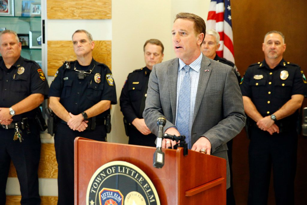 Texas Representative Pat Fallon of Dist. 106 announced his bill that would provide a property tax exemption to surviving spouses of first responders killed in the line of duty during a press conference at the Little Elm Safety Center in Little Elm, Texas, Thursday, March 2, 2017. House Bill 2524 and House Joint Resolution 88 are in memory of fallen Little Elm police detective Jerry Walker. Flanking him were representative of local police departments, Little Elm Mayor David Hillock and Police Chief Rodney Harrison. (Tom Fox/The Dallas Morning News)