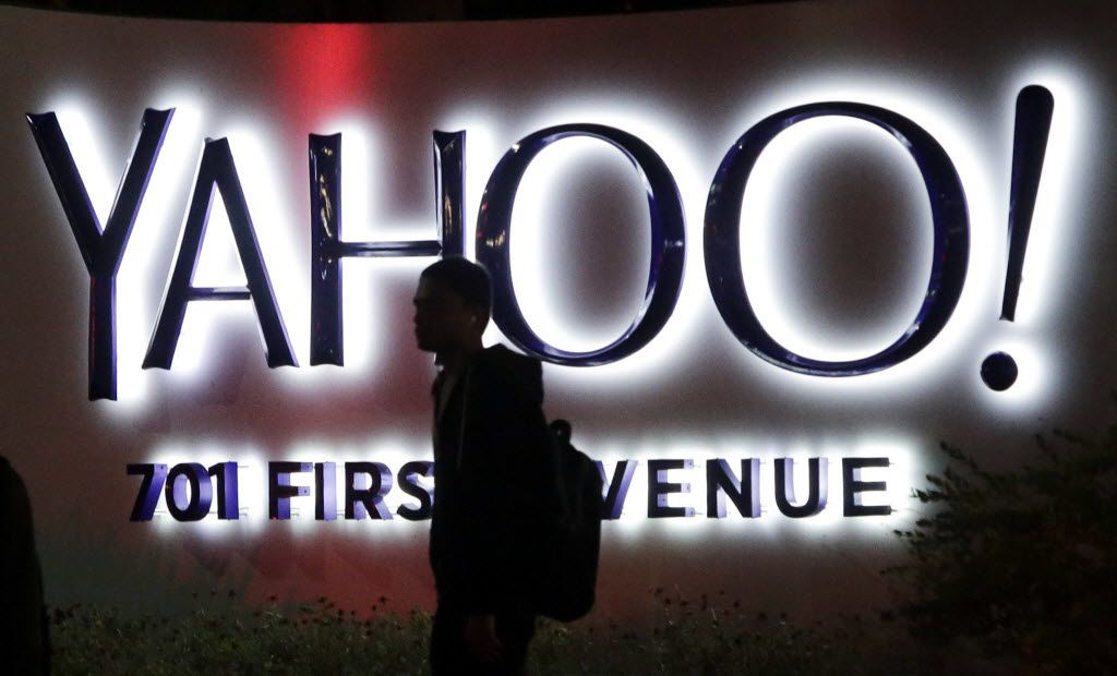 A passerby walks in front of a Yahoo sign at the company's headquarters in Sunnyvale, Calif. (AP Photo/Marcio Jose Sanchez, File)