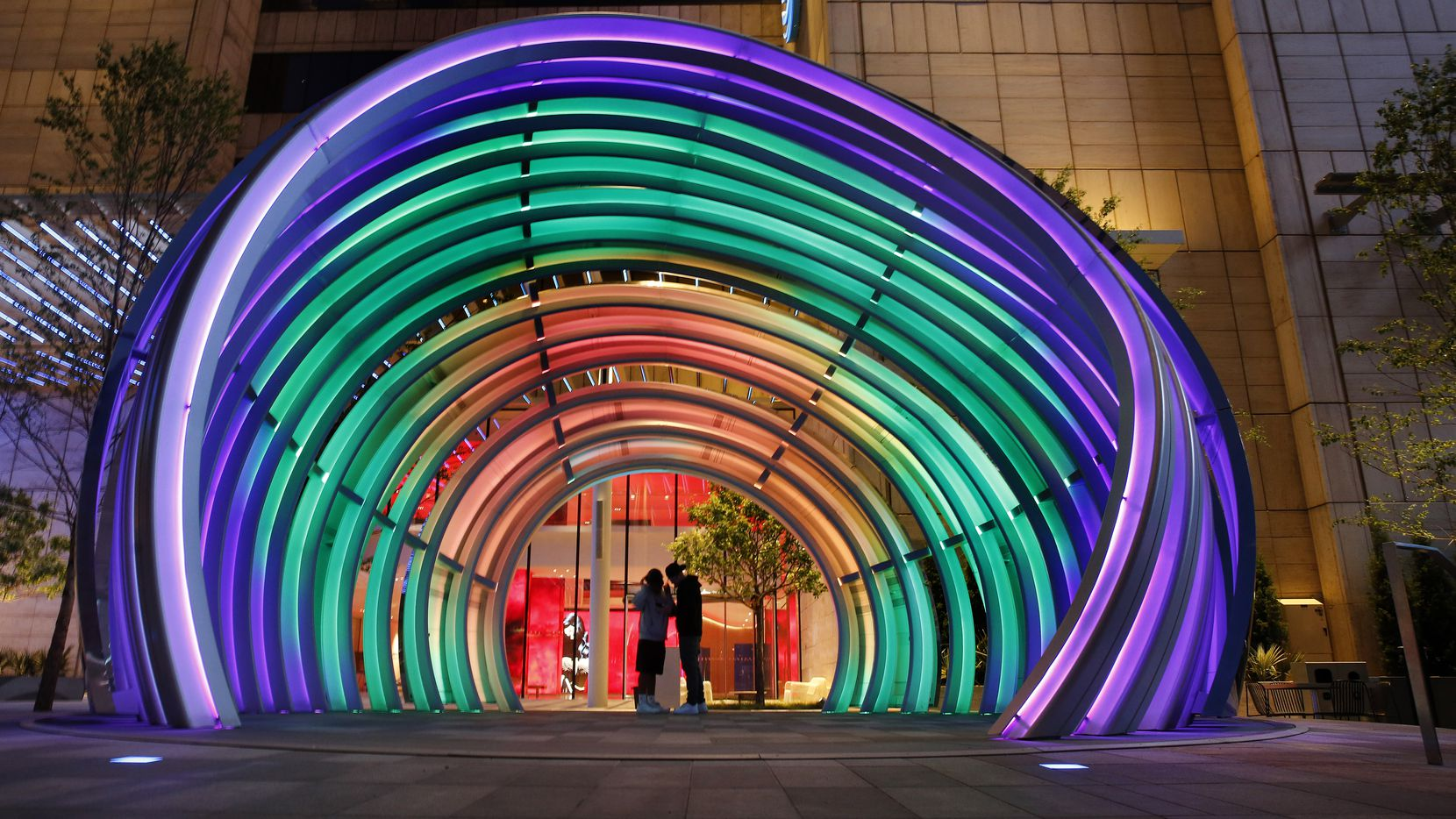 Kids hang out in the 30-foot tall LED-lit Globe in the AT&T Discovery District. The art piece will serve as a stage for the new outdoor concert series in the area.