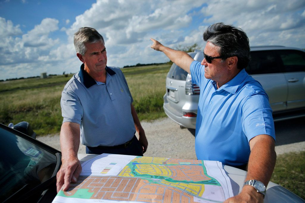 Northstar developers Kim Gill (right) and Tim Fleet look over plans for another development, the 732-acre Morningstar project  near Aledo in Tarrant County.
