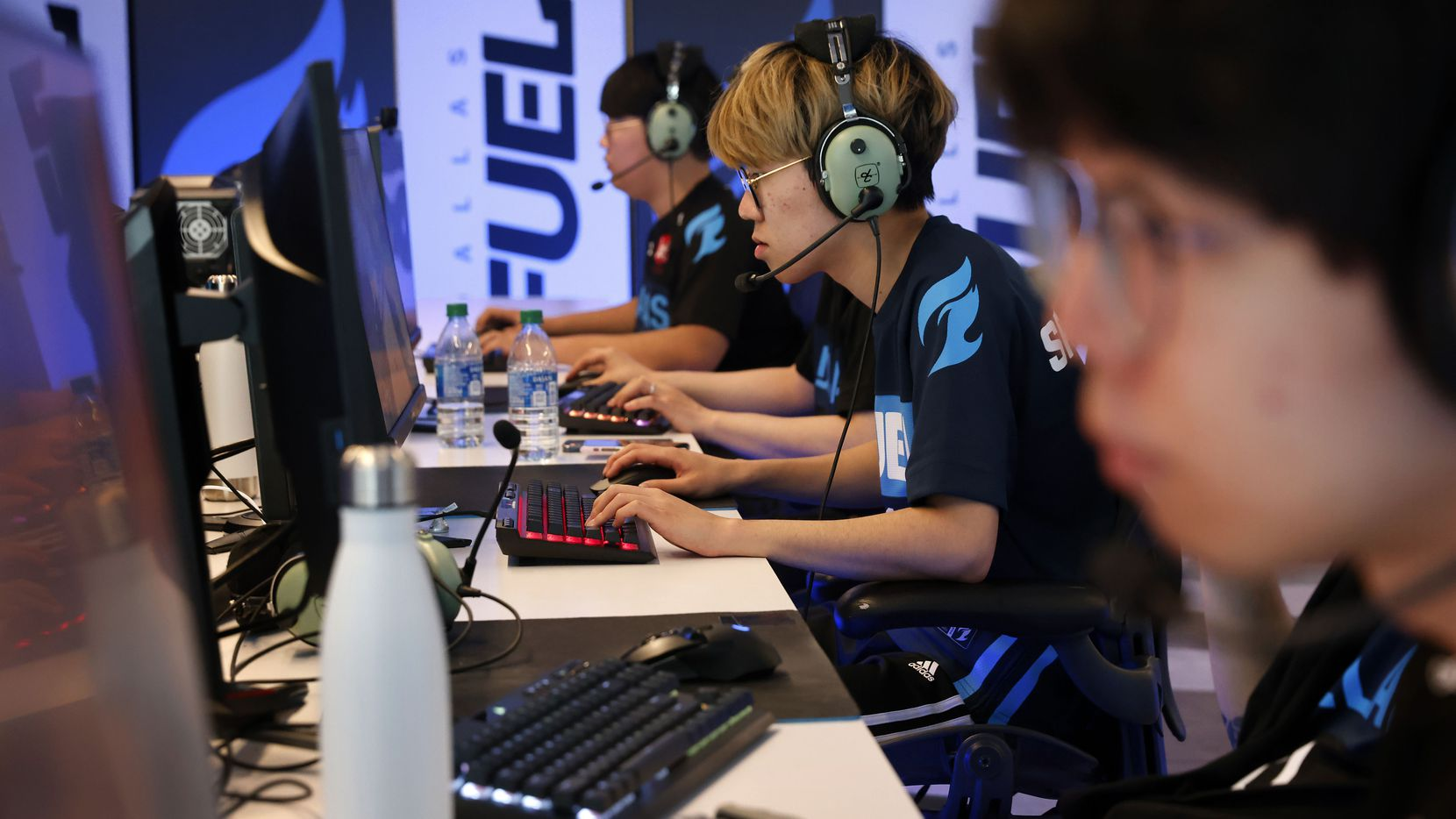 """Dallas Fuel Overwatch League players (from left) Hanbeen 'Hanbin' Choi, Yeonghan 'SP9RK1E' Kim, and  Kim """"DoHa"""" Dong-Ha practice ahead of their season opener against Houston at Envy Gaming Headquarters in Dallas, Monday, March 29, 2021. (Tom Fox/The Dallas Morning News)"""