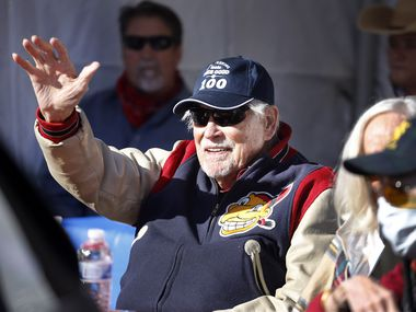 Eddie Robinson, the oldest living former MLB player, waves to friends who delivery an early 100th birthday wish. He will turn 100 on December 15th. To share his birthday with friends, his family orchestrated a drive-by celebration outside his Fort Worth home, Saturday, December 12, 2020.