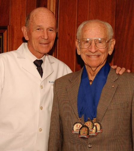Fitness expert Dr. Kenneth Cooper (left) with Masters runner Orville Rogers, a world record holder.