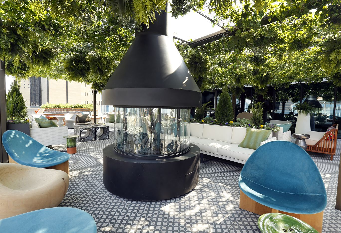 There's large fireplace and funky furniture on the Catbird's outdoor patio area.