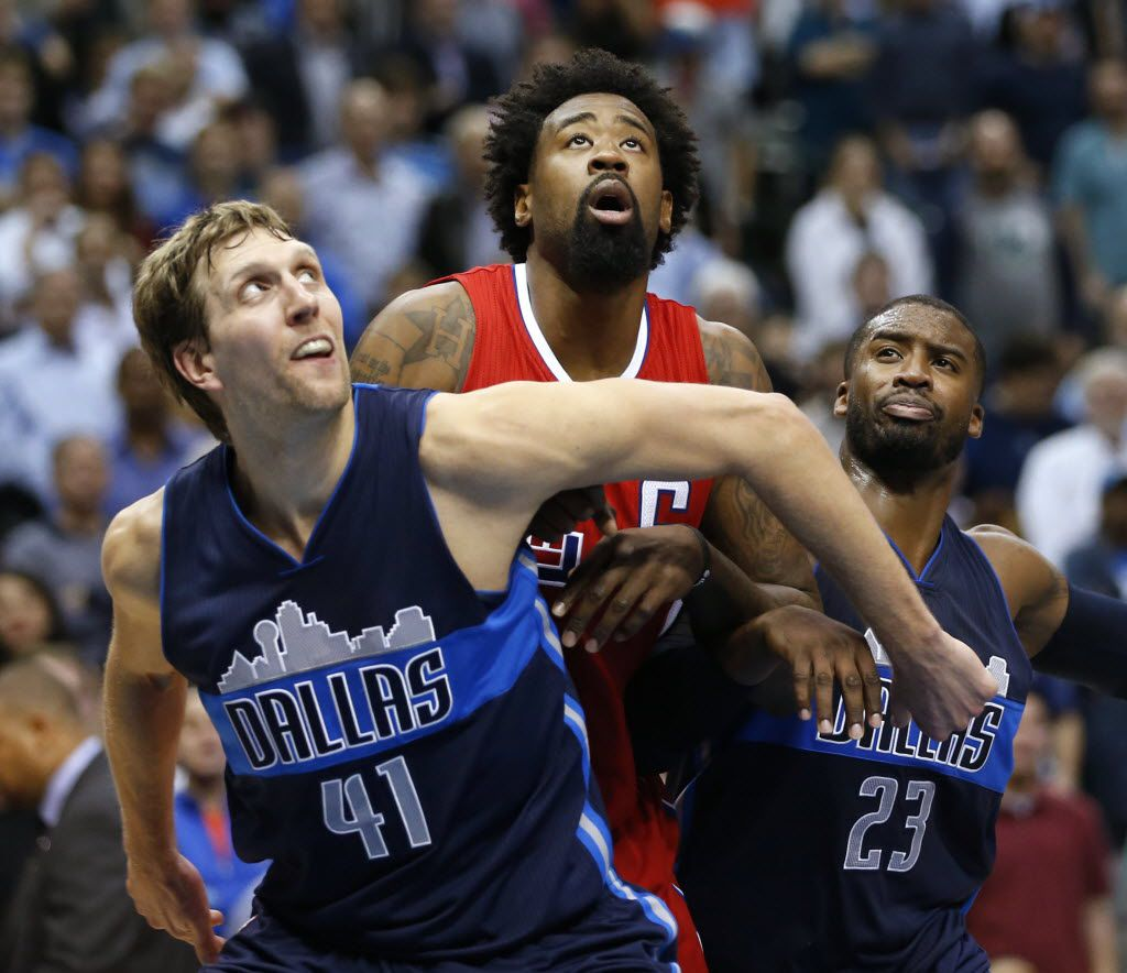 Dallas Mavericks forward Dirk Nowitzki (41) and Dallas Mavericks guard Wesley Matthews (23) box out Los Angeles Clippers center DeAndre Jordan (6) on a free throw attempt during the second half of play at American Airlines Center in Dallas, on Wednesday, November 11, 2015. Dallas Mavericks defeated the Los Angeles Clippers 118-108. (Vernon Bryant/The Dallas Morning News)