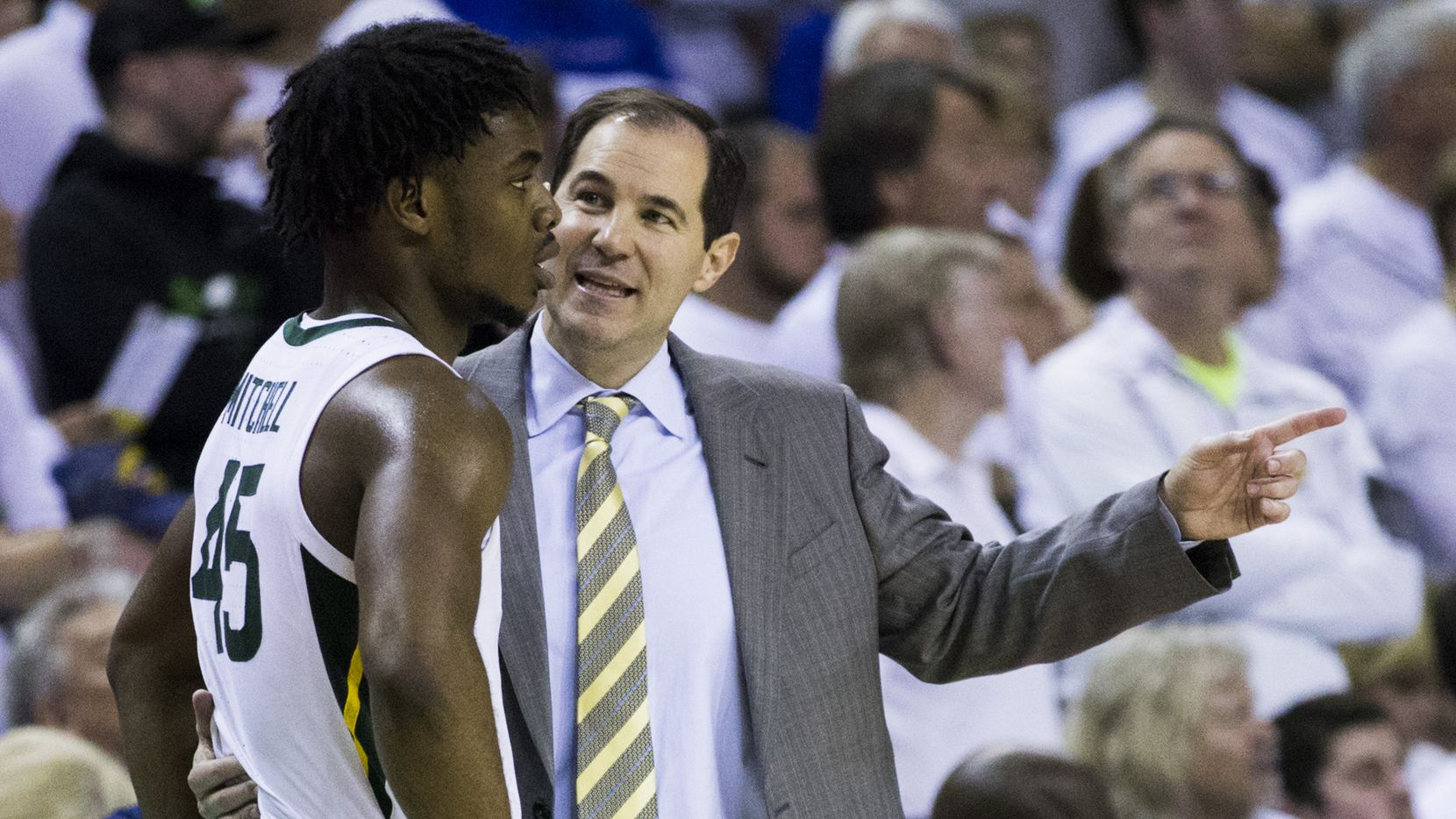 Baylor Bears guard Davion Mitchell (45) talks with head coach Scott Drew during the second half of an NCAA men's basketball game between Baylor University and Kansas University on Saturday, February 22, 2020 at Ferrell Center on the Baylor University Campus in Waco.