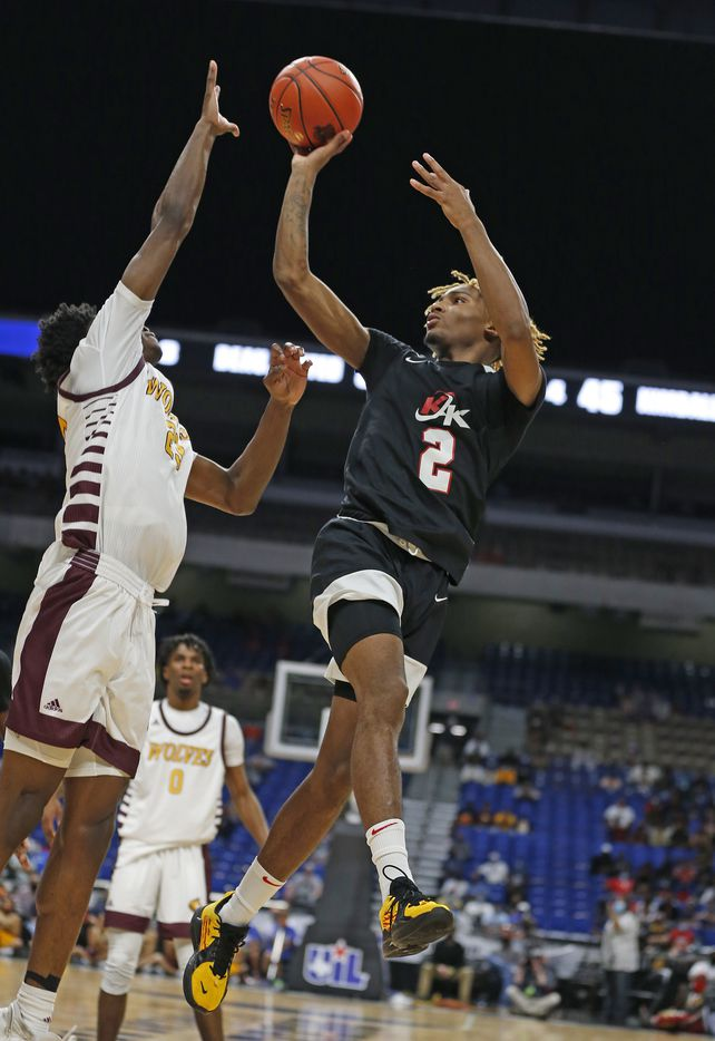 Dallas Kimball Arterio Morris #2 shoots over a defender. UIL boys Class 5A basketball state championship game on Friday, March 12, 2021 at the Alamodome.