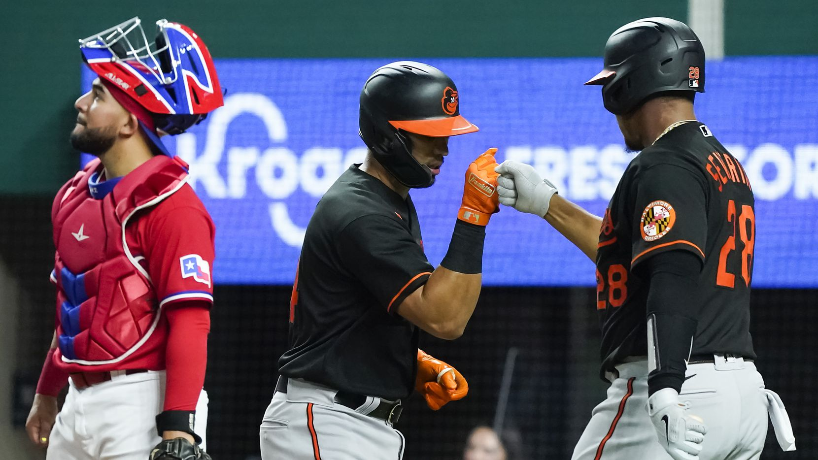 Baltimore Orioles second baseman Rio Ruiz celebrates with catcher Pedro Severino after hitting a solo home run during the fourth inning as Texas Rangers catcher Jose Trevino looks away at Globe Life Field on Friday, April 16, 2021.