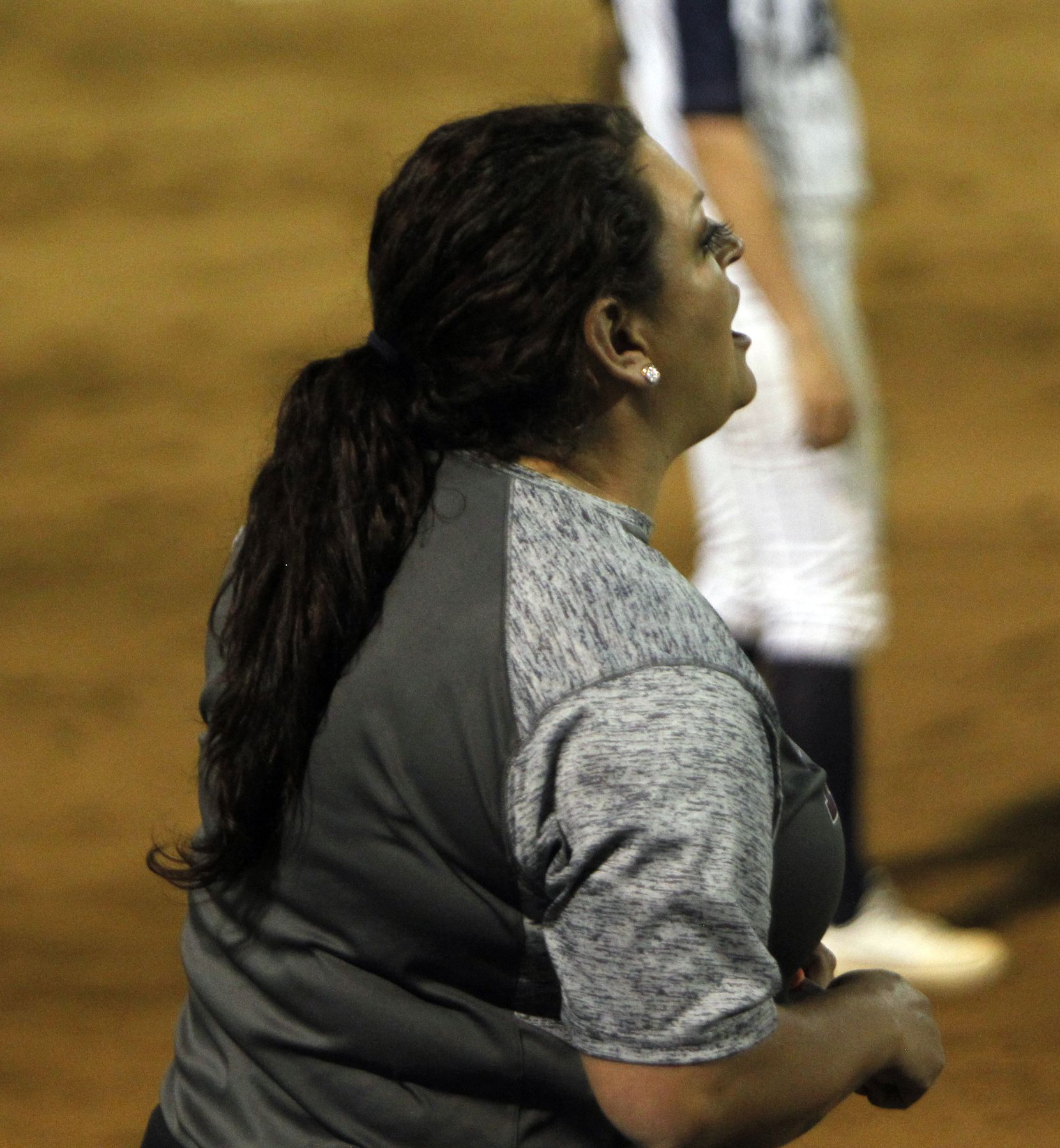 Plano head coach Brittany Welch coaches from outside the team dugout during the bottom of the 3rd inning of play against Flower Mound. The two teams played their District 6-6A softball game at Flower Mound High School in Flower Mound on March 23, 2021. (Steve Hamm/ Special Contributor)