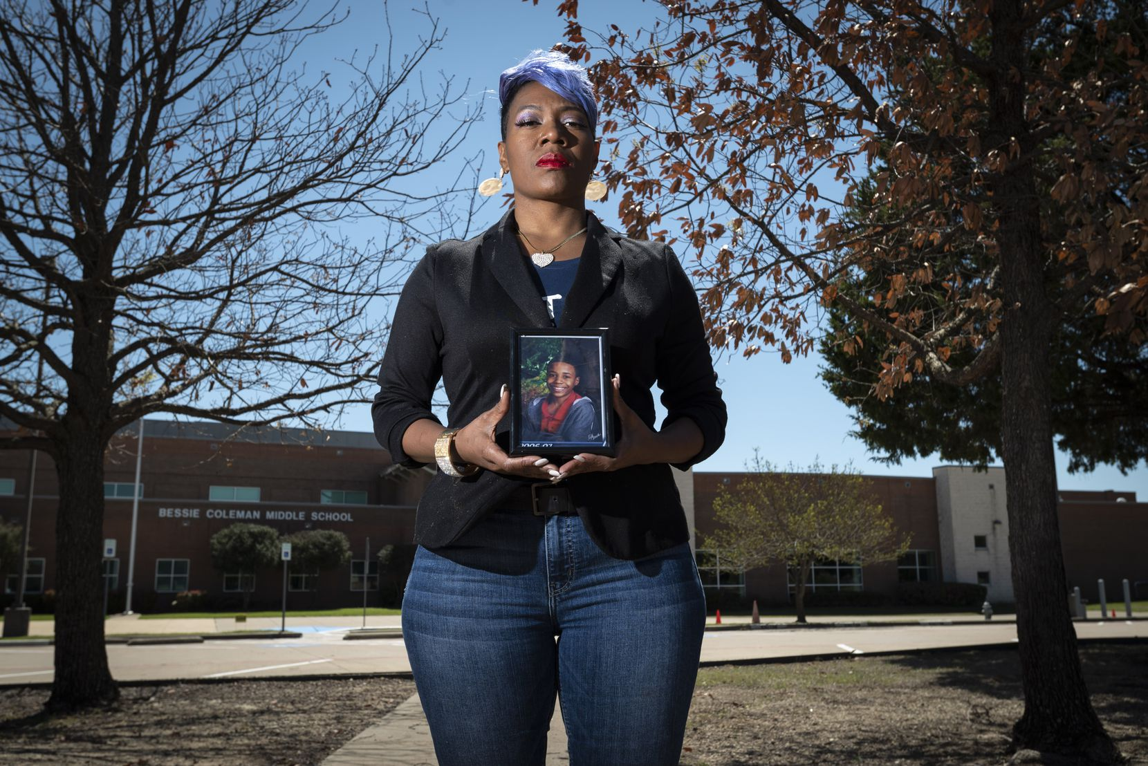 """Donna Fields, holding a photo of son Marcus Bell Jr. when he was 12, stands outside Bessie Coleman Middle School in Cedar Hill, which Bell was attending when he says Pastor Rickie Rush sexually assaulted him in Rush's office at Inspiring Body of Christ Church. """"Rush needs to be held accountable,"""" Bell says. """"He doesn't need to be doing this to anybody else."""""""
