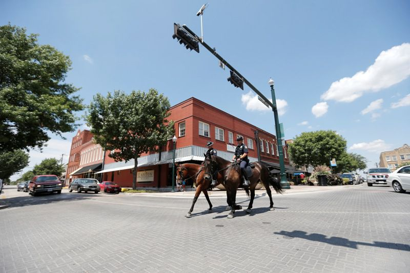 A mounted patrol is pictured in McKinney in 2015. Alpha & Omega Mounted Patrol, based in Southlake, is celebrating 30 years as the nation's only private mounted patrol service.