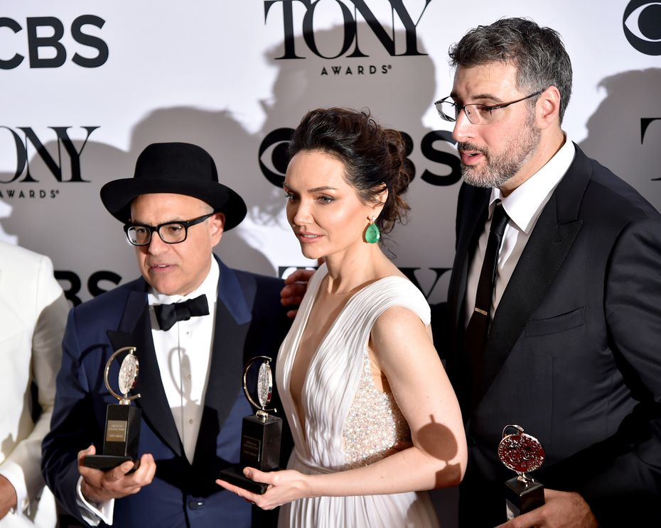 """From left: Composer David Yazbek, actress Katrina Lenk and producer Orin Wolf show off their Tonys for """"The Band's Visit."""""""