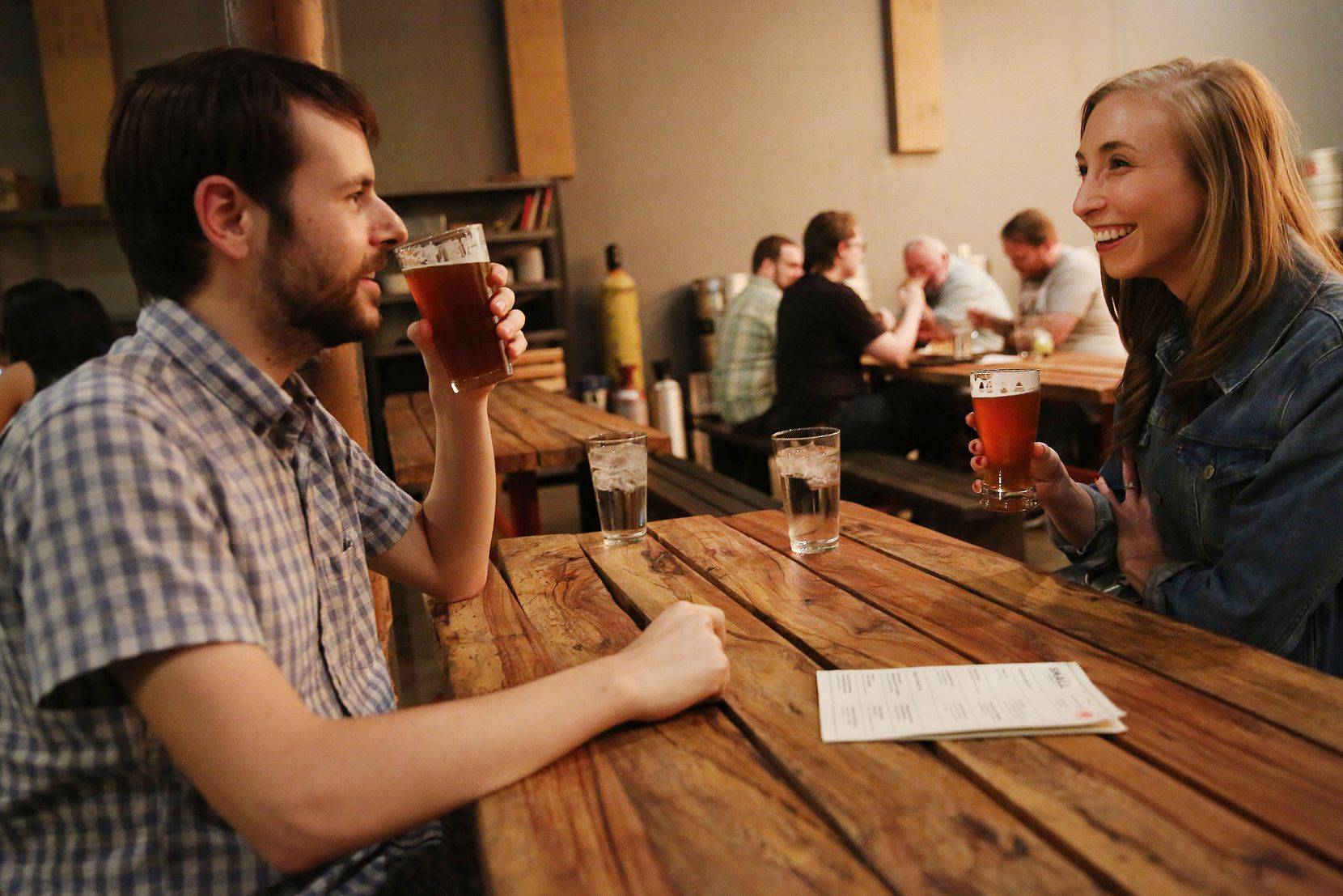 Greg Spagnolo and Jaci Spagnolo, of Dallas, drink beers inside Small Brewpub in Oak Cliff.