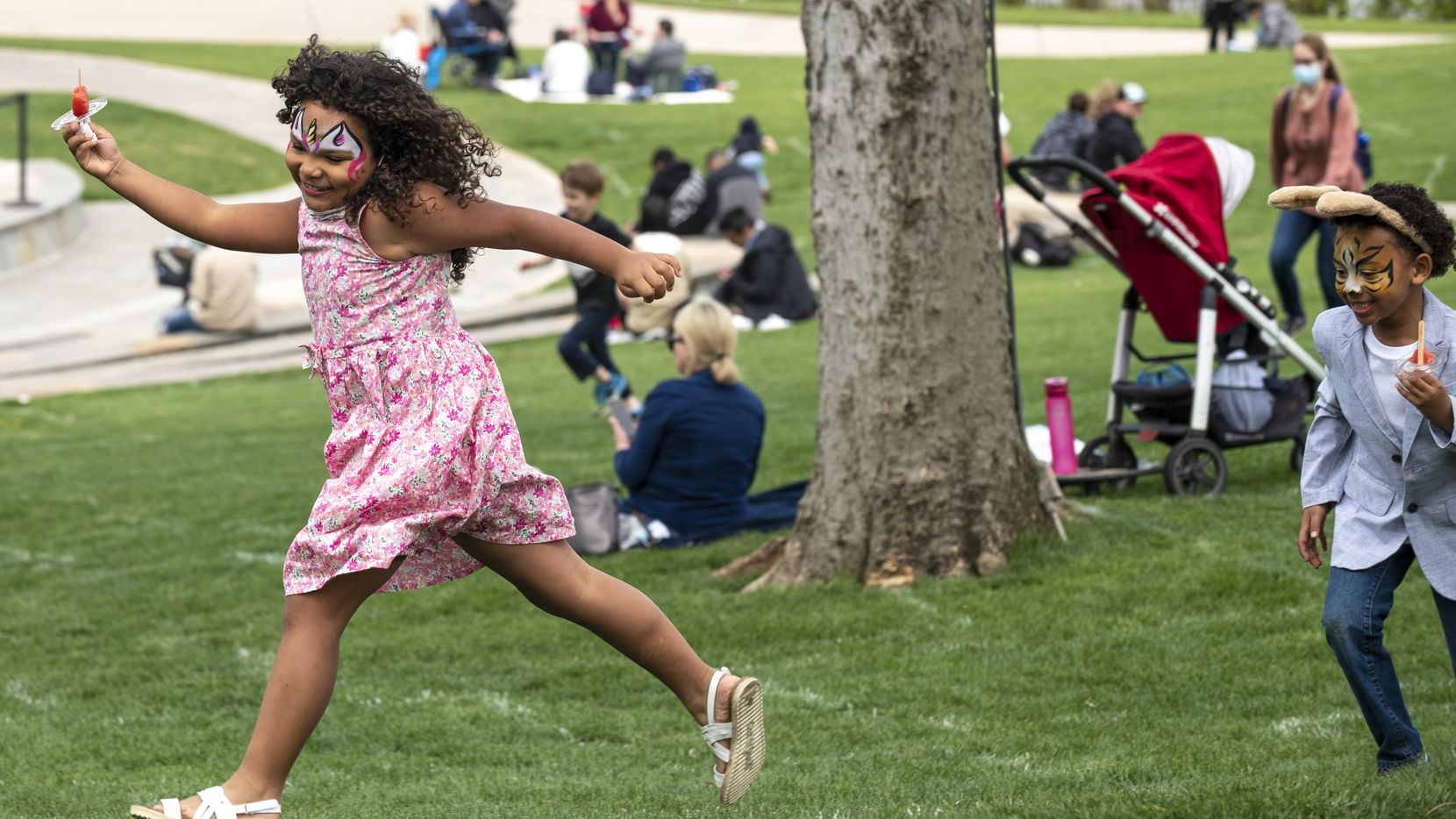 Isadora Peña, 6, runs freely while playing with her cousin Kaniel Williams, 5, of Austin, as her family visited with out-of-town relatives for Easter weekend at Dallas Arboretum, on Saturday, April 03, 2021 in Dallas.