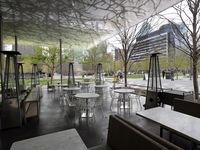 Empty outdoor seating at Savor restaurant at Klyde Warren Park on March 21, 2020.