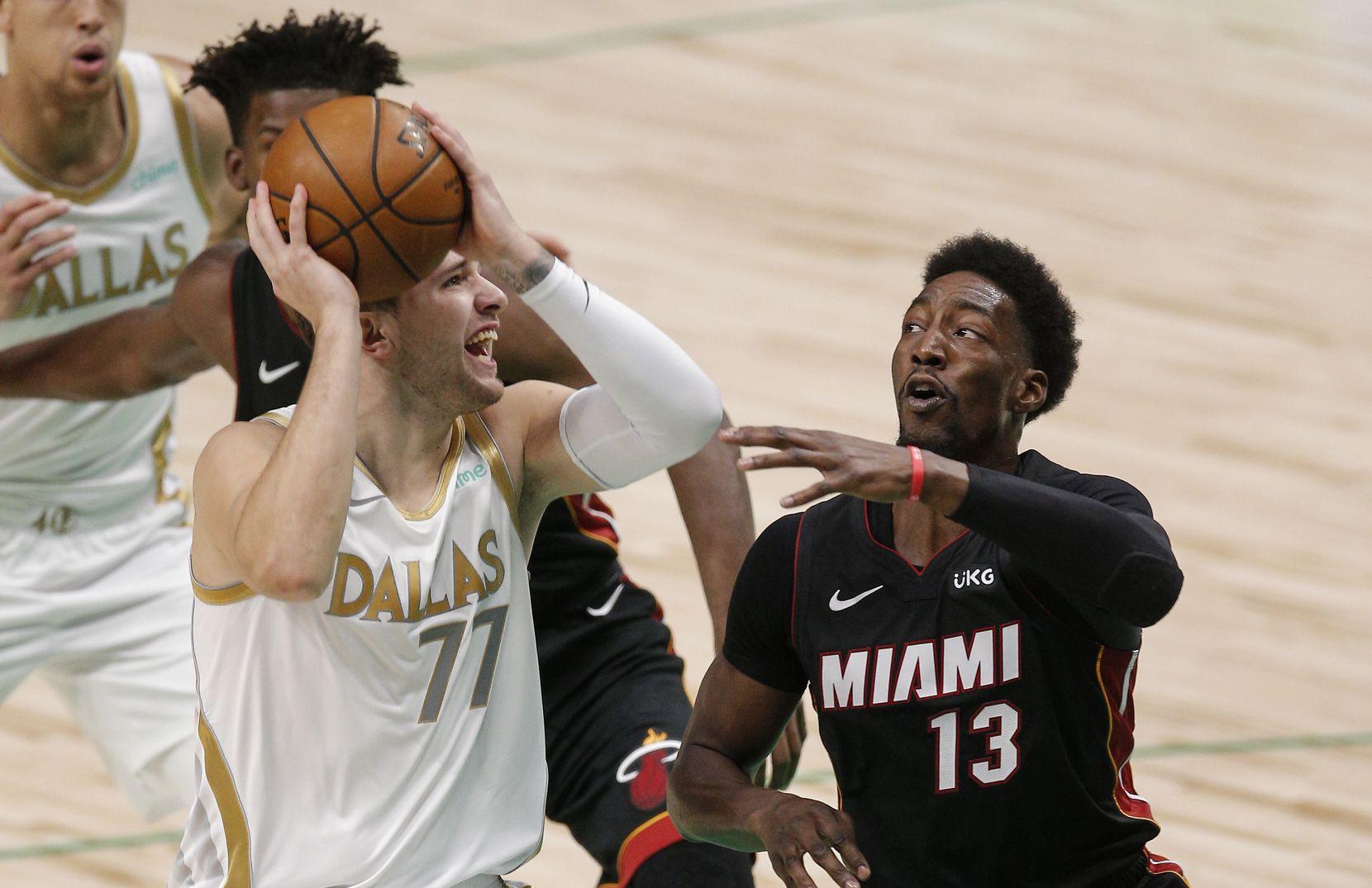 Dallas Mavericks guard Luka Doncic (77) attempts a shot as Miami Heat forward Bam Adebayo (13) defends during the first half of an NBA basketball game, Friday, January 1, 2021. (Brandon Wade/Special Contributor)
