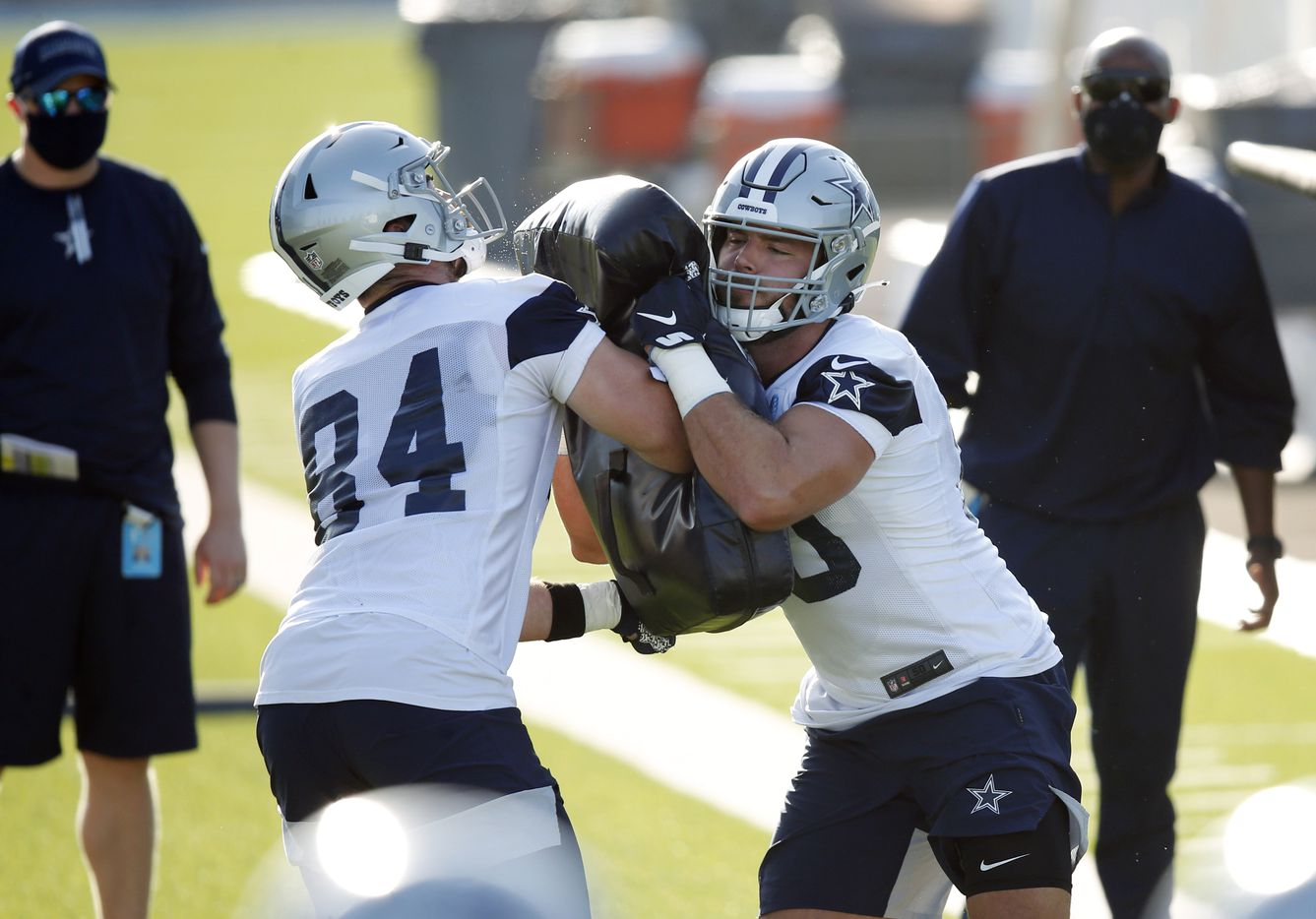 Dallas Cowboys tight end Blake Bell (80) attempts to run through Dallas Cowboys tight end Sean McKeon (84) on a drill during the first day of training camp at Dallas Cowboys headquarters at The Star in Frisco, Texas on Friday, August 14, 2020. (Vernon Bryant/The Dallas Morning News)