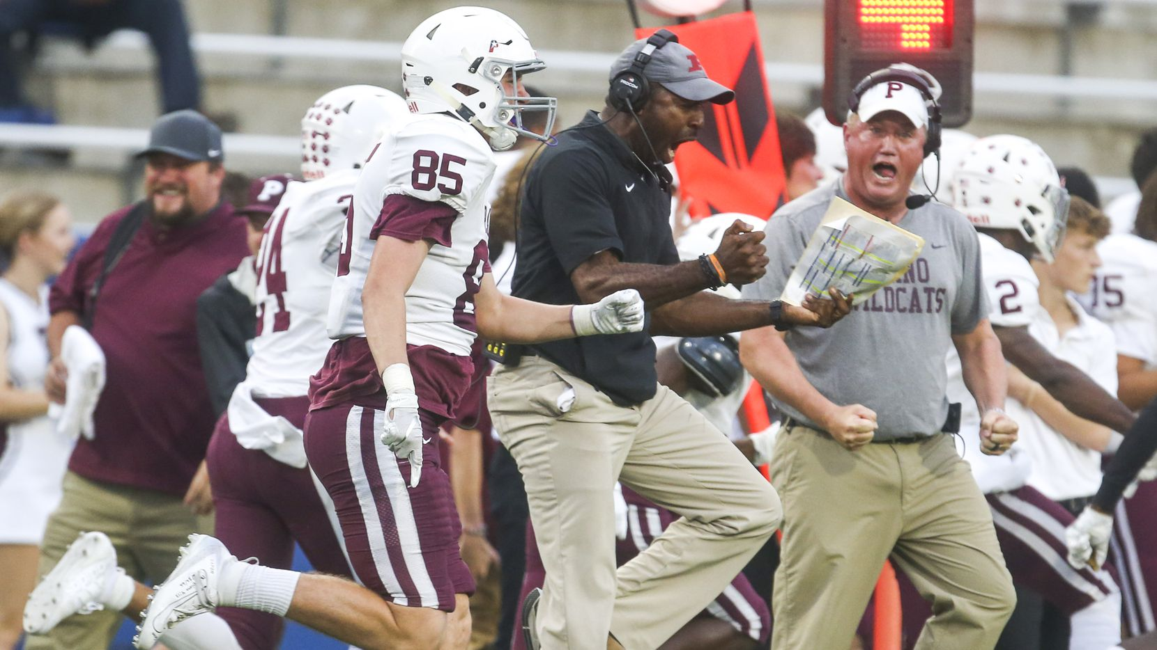 The Plano team celebrates an Isaiah Calhoun touchdown during the first half of a high school football game between McKinney and Plano on Thursday, October 10, 2019 at McKinney ISD Stadium in McKinney, Texas.