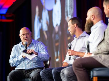 Rangers beat writer Evan Grant (left) asks former players David Murphy (second from left), Mike Napoli (third from left) and Michael Young their favorite Globe Life Park memory during the Rangers' all-time team luncheon at Live by Loews Hotel in Arlington on Friday, Sept. 27, 2019.