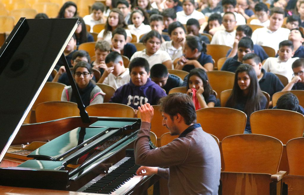 Cliburn Silver Medalist Kenny Broberg performs for students and teachers at South Hills Elementary School in Fort Worth, Texas (David Woo/The Dallas Morning News)