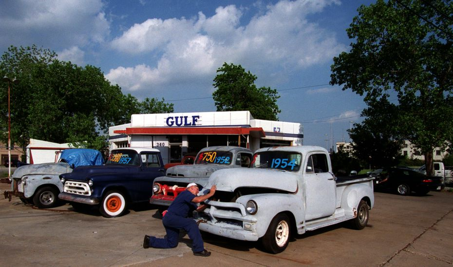 Riegel Gulf Service in Deep Ellum, which closed in 2002, has reopened as Thunderbird Station in 2020. In this file photo, Maynard Riegel starts to work on one of several vintage pickups he has for sale as another inspection sticker customer pulls in at right.