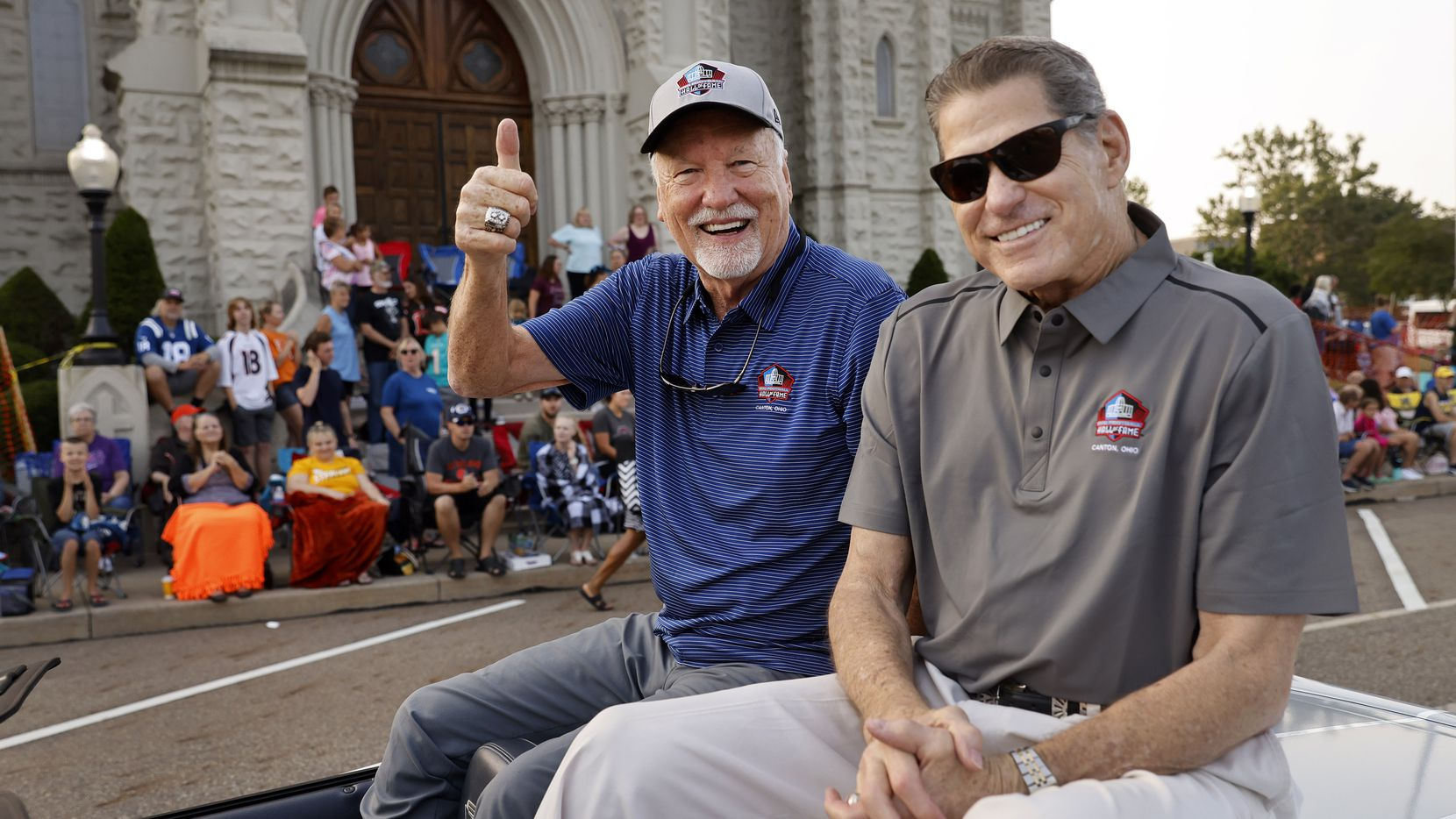 Dallas Cowboys Pro Football Hall of Fame inductee Cliff Harris (left) and former Cowboys safety Charlie Waters pose for a photo along the Canton Repository Grand Parade route in downtown Canton, Ohio, Saturday, August 7, 2021.