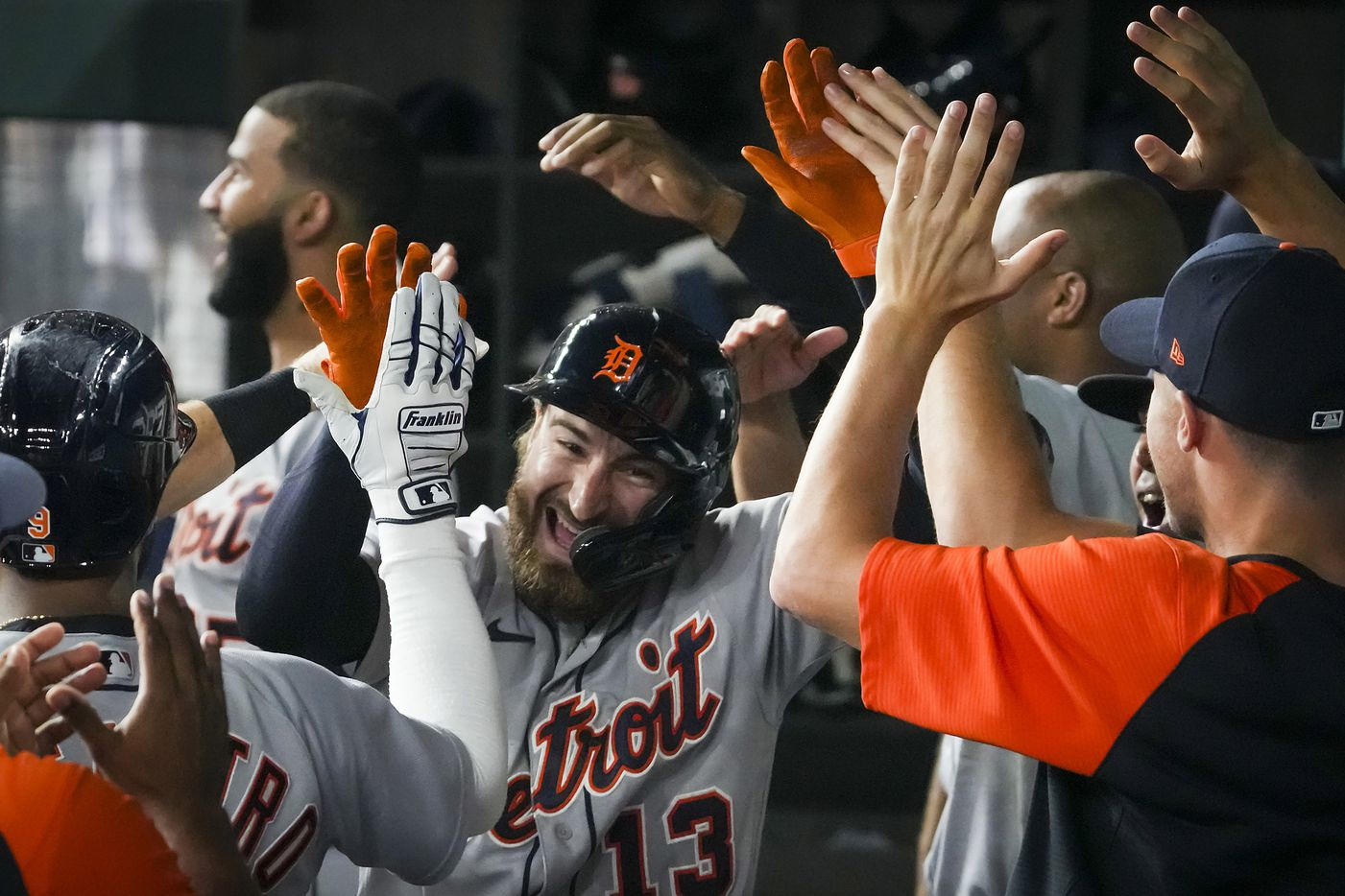 Detroit Tigers pinch hitter Eric Haase celebrates with teammates in the dugout after hitting a 3-run home run to tie the game during the seventh inning against the Texas Rangers at Globe Life Field on Tuesday, July 6, 2021.