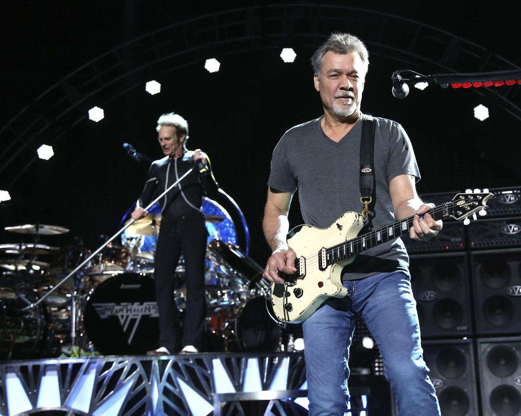 David Lee Roth, left, and Eddie Van Halen of Van Halen perform on Aug. 13, 2015, in Wantagh, N.Y.