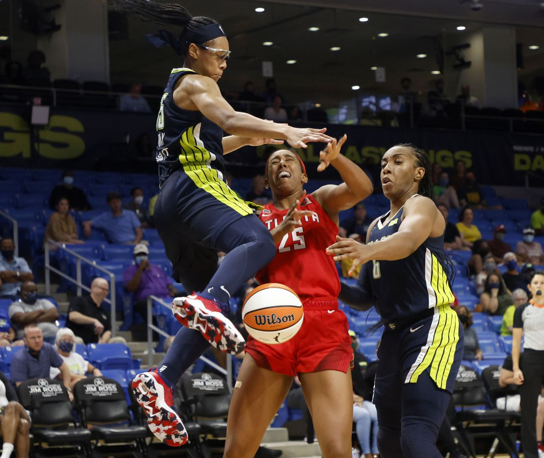 Dallas Wings guard Allisha Gray, left fouls Atlanta Dream forward Monique Billings (25) as Wings forward Kayla Thornton (6) defends, during the second half of their WNBA basketball game in Arlington, Texas on Sept. 2, 2021. Dallas won 72-68. (Michael Ainsworth/Special Contributor)