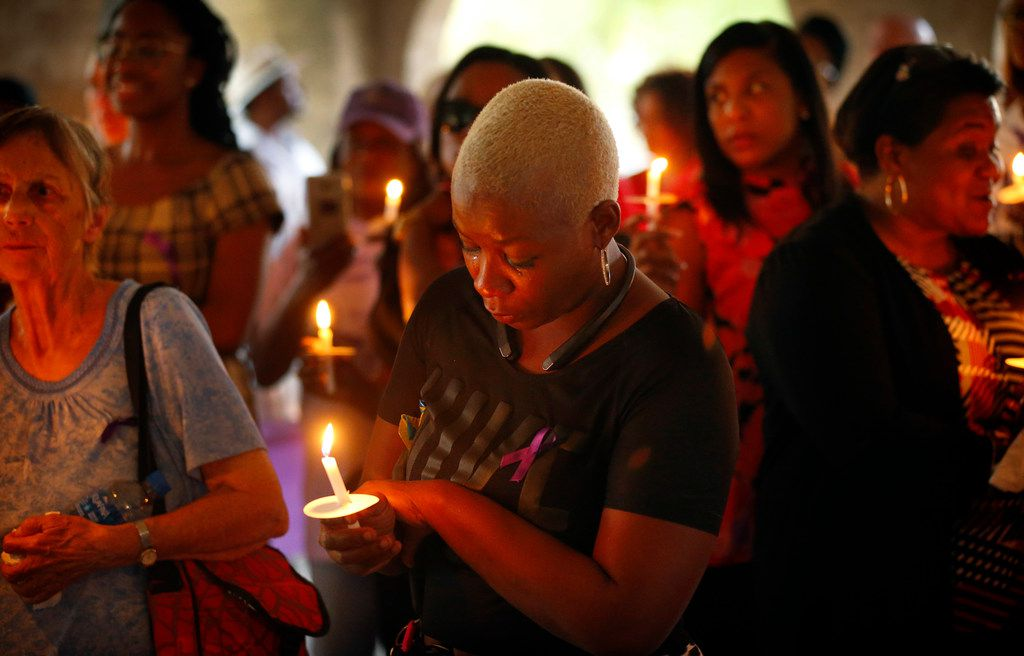 Donna Alexander's friend Ireshia Brown of Cedar Hill is overcome with emotion during a vigil, Monday, October 1, 2018 at Cole Park in the Uptown area of Dallas. Brown said Donna helped get her fashion design business off the ground after moving to the Dallas area. Donna's estranged boyfriend Nathaniel Mitchell, 34, was charged with murder after Alexander died a week after being beaten. Alexander was founder of the Deep Ellum's Anger Room, a warehouse designed to help people cope with stress. (Tom Fox/The Dallas Morning News)