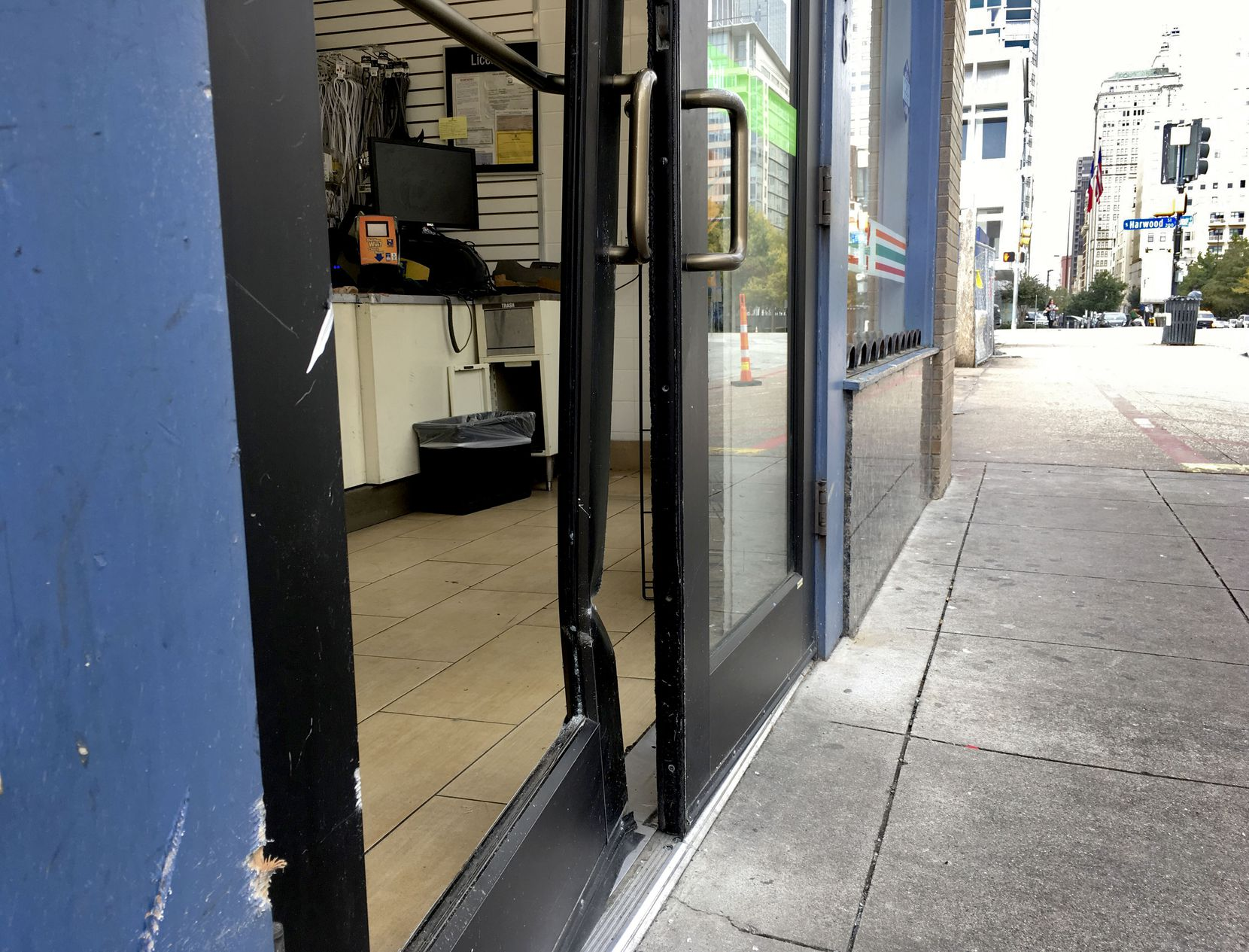 The cash machine shattered the glass and bent the frame of the door as it was pulled free.