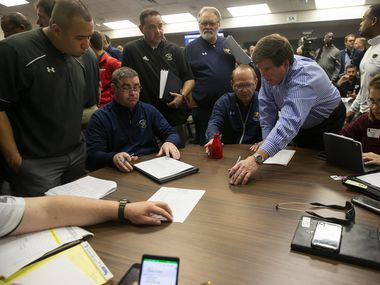 High school football coaches, pictured during UIL realignment in 2020, are trying to fill an unexpectedly high number of coaching vacancies before the 2021 season starts.