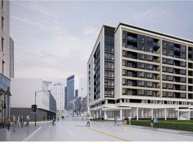 The nine-story apartment and retail building is planned at Harwood and Jackson streets.