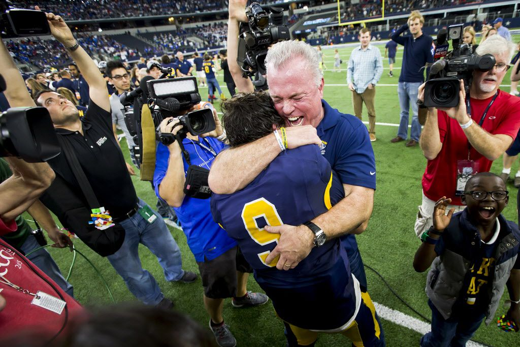 Highland Park quarterback John Stephen Jones (9) gets a hug from his father, Dallas Cowboys Chief Operating Officer/Executive Vice President Stephen Jones, after the Scots' victory over Temple in the UIL Class 5A Division I state football championship football game at AT&T Stadium on Saturday, Dec. 17, 2016, in Arlington.  Highland Park won the game 16-7. (Smiley N. Pool/The Dallas Morning News)