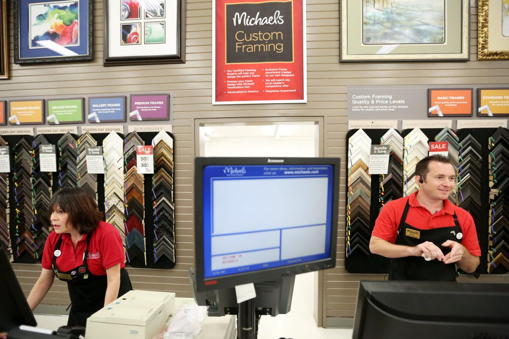 Framers Joanna Fisher (left) and Nathan Eggar, both of Plano, worked on customer orders inside the Michaels store at the Park Place Shopping Center in Plano in this file photo.