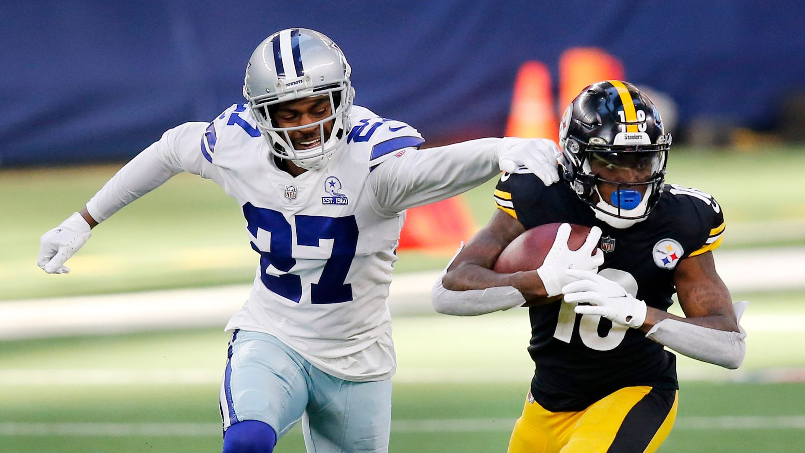 Dallas Cowboys cornerback Trevon Diggs (27) misses a tackle of Pittsburgh Steelers wide receiver Diontae Johnson (18) during the second quarter at AT&T Stadium in Arlington, Texas Sunday, November 8, 2020.