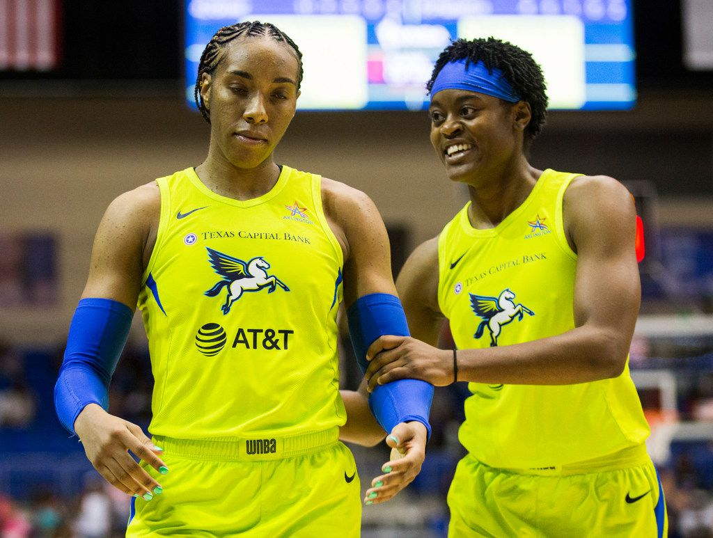 Dallas Wings guard Kaela Davis (3, right) tries to calm down forward Kayla Thornton (6) after a foul call during the third quarter of a WNBA game between the Dallas Wings and the Phoenix Mercury on Saturday, July 20, 2019 at UTA's College Park Center in Arlington, Texas. (Ashley Landis/The Dallas Morning News)