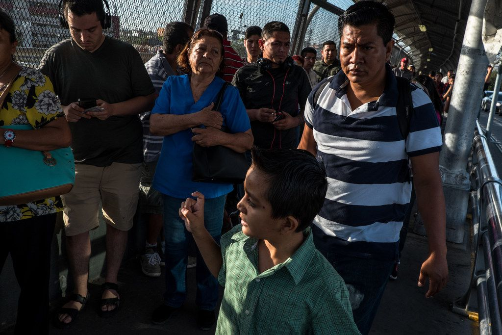 Cristopher Yovani Monjel, 7, left, is followed by his father Edgar, 34, right, as they walk up the Paso del Norte Bridge toward a U.S. Port of Entry in Juarez on Thursday, Aug. 1, 2019. The Monjel family was headed to their first immigration court date after being sent back to Mexico a month earlier under the Remain In Mexico program.