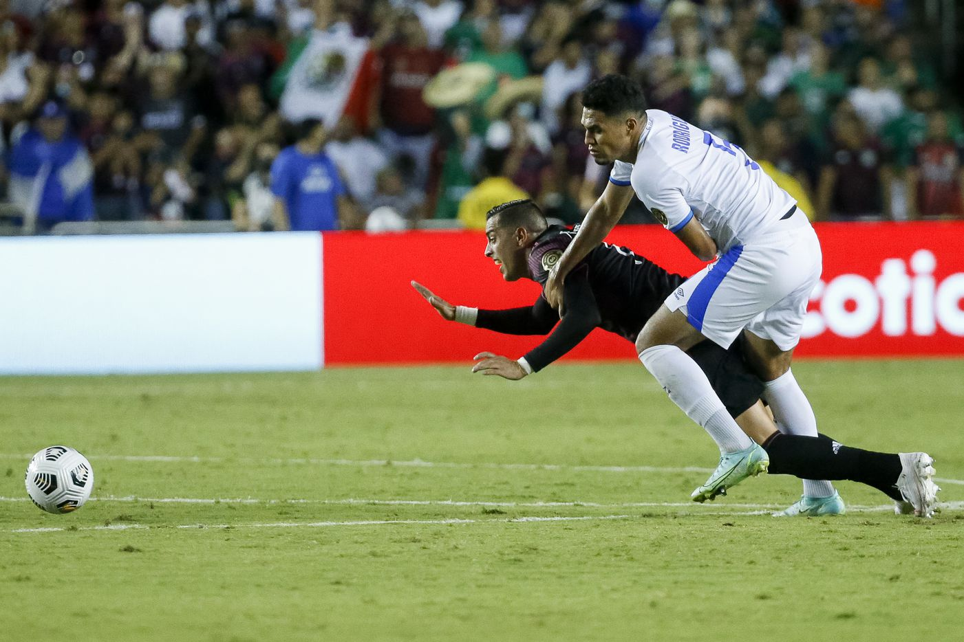 El Salvador defender Ronald Gomez (5) tackles Mexico forward Rogelio Funes Mori (11) during the second half of a CONCACAF Gold Cup Group A soccer match at the Cotton Bowl on Sunday, July 18, 2021, in Dallas. (Elias Valverde II/The Dallas Morning News)