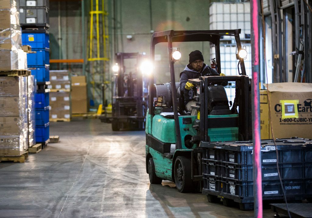 Francisco Garza drives a forklift through the Bespoke Logistics warehouse in McAllen. The warehouse acts as a midpoint for shipments going to and from the U.S. and Mexico.