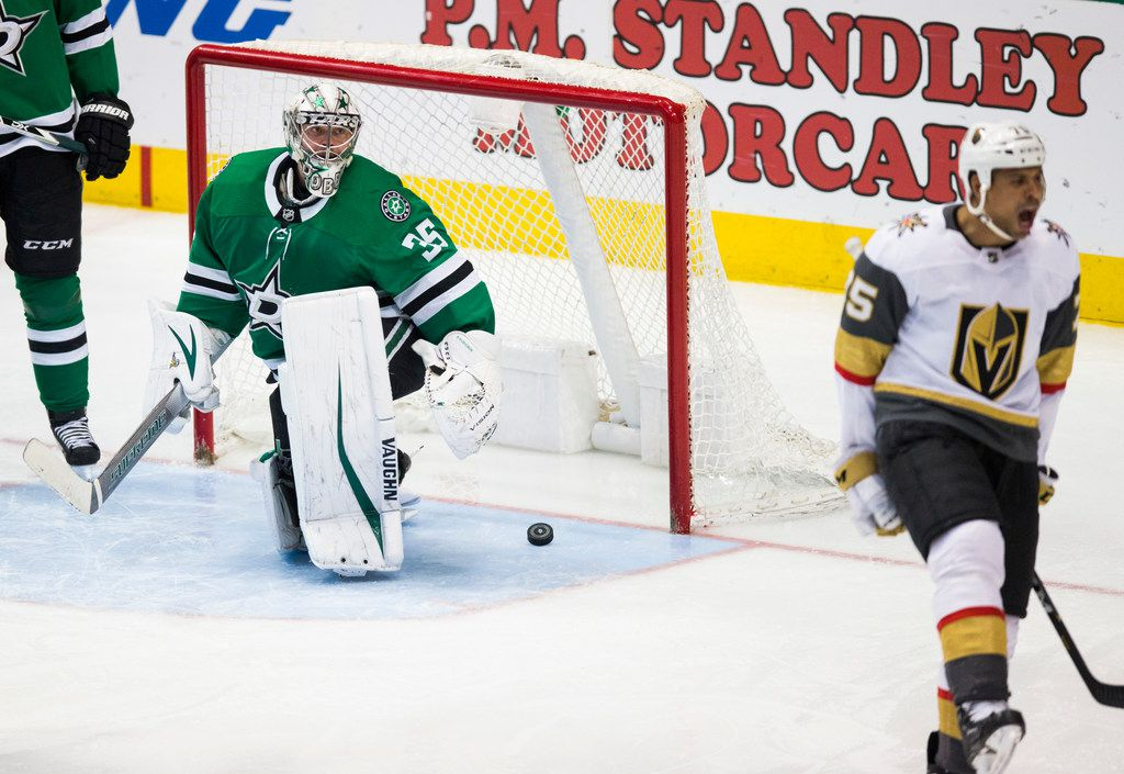Dallas Stars goaltender Anton Khudobin (35) watches Vegas Golden Knights right wing Ryan Reaves (75) react after Khudobin allowed a Vegas Golden Knights goal during the third period of an NHL game between the Dallas Stars and the Vegas Golden Knights on Friday, March 15, 2019 at American Airlines Center in Dallas. (Ashley Landis/The Dallas Morning News)