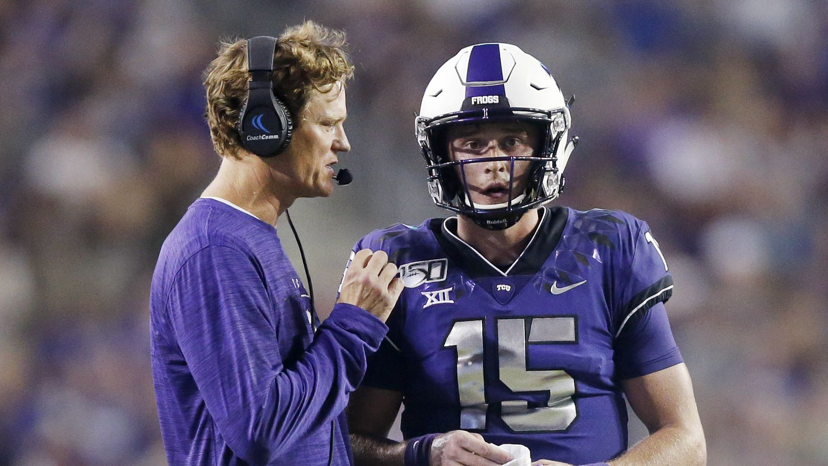 FILE - TCU co-offensive coordinator Sonny Cumbie (left) confers with quarterback Max Duggan (15) during the second quarter of a game against Arkansas-Pine Bluff at Amon G. Carter Stadium in Fort Worth on Saturday, Aug. 31, 2019.