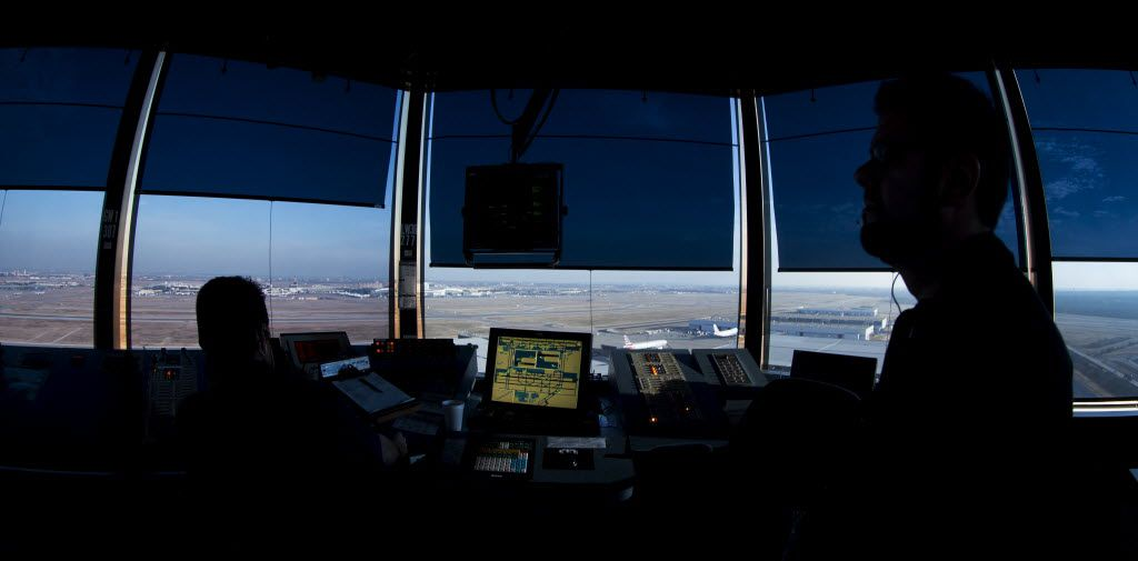Air traffic controllers work at DFW Airport's west air traffic control tower in Irving.