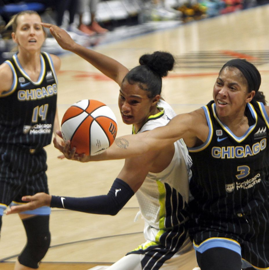 Dallas Wings forward Satou Sabally (0), center, battles with Candace Parker (3) for a rebound during second half action. Dallas defeated Chicago 100-91.The two WNBA teams played their game at College Park Center in Arlington on July 2, 2021. (Steve Hamm/ Special Contributor)